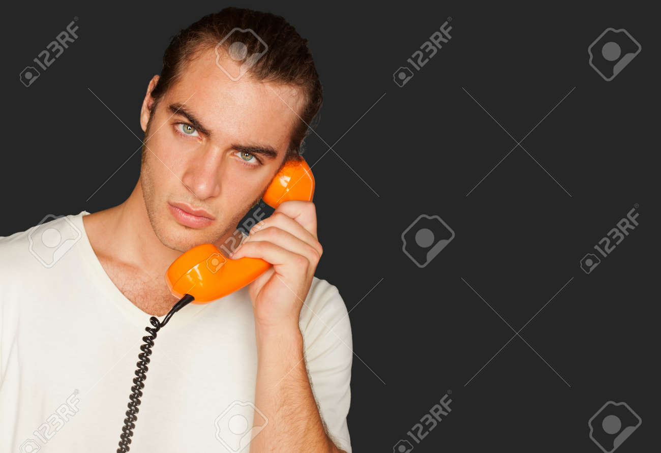 Portrait Of A Man Talking On Telephone Isolated On Black Background Stock Photo - 14706982
