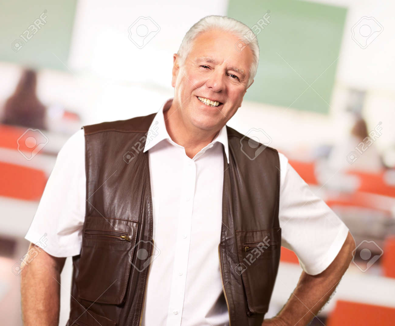 Senior Man Standing With Hand On Hips, Indoor Stock Photo - 14826084