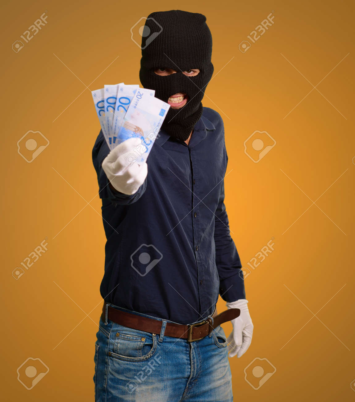 Burglar In Face Mask On Coloured Background Stock Photo - 15187262