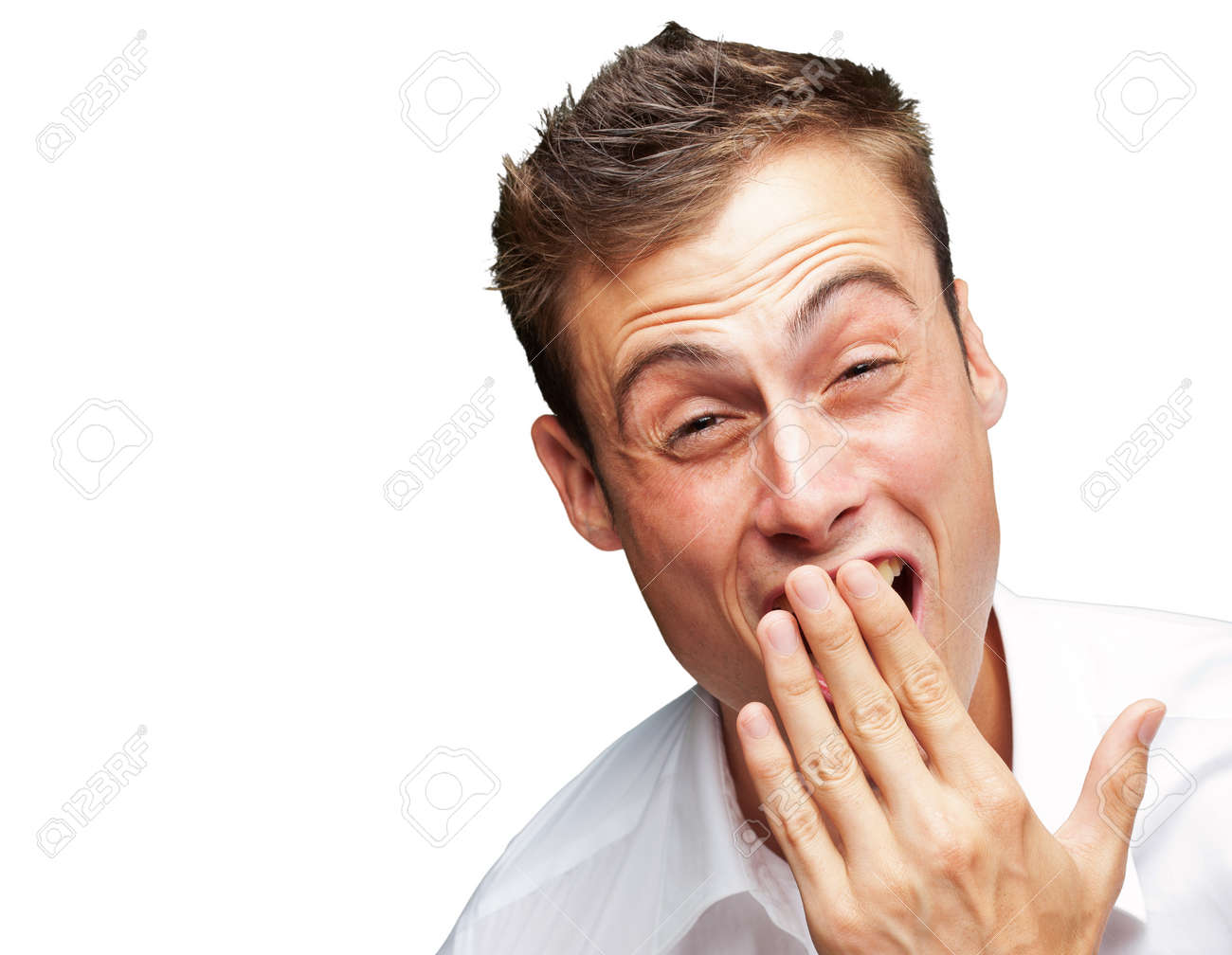 Portrait Of Young Man Covering His Mouth With Hand On White Background Stock Photo - 15853629