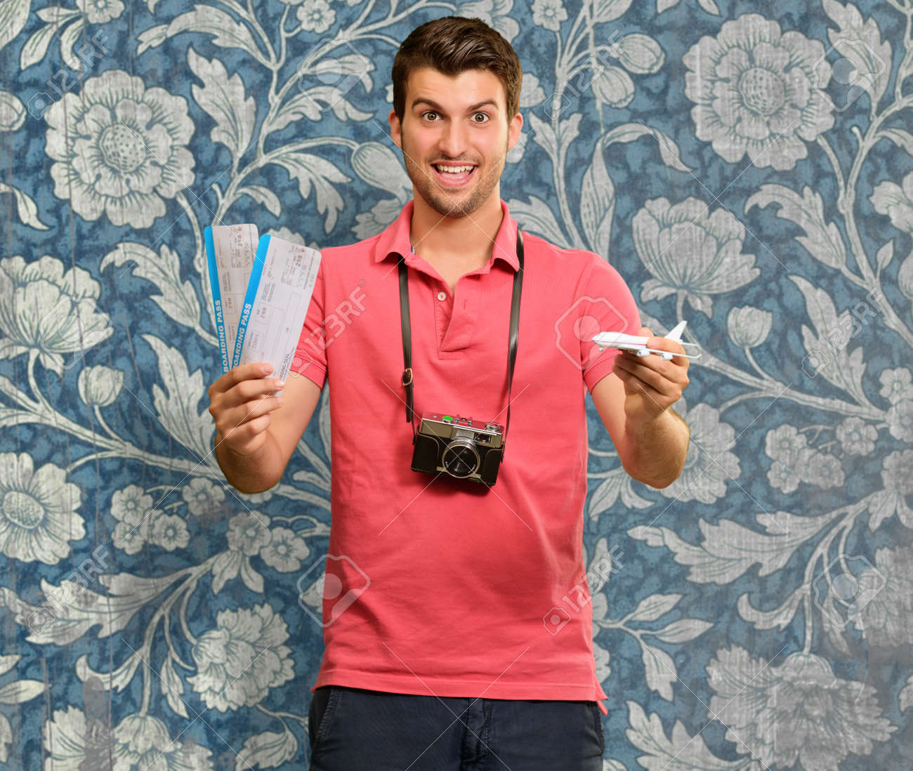 Man holding boarding pass and airplane, wallpaper Stock Photo - 16039635