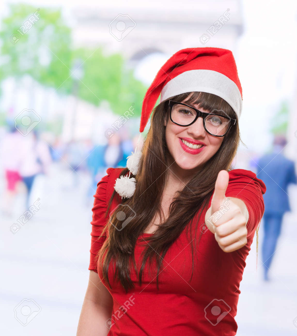 christmas woman doing a thumbs up gesture, outdoor Stock Photo - 16290846