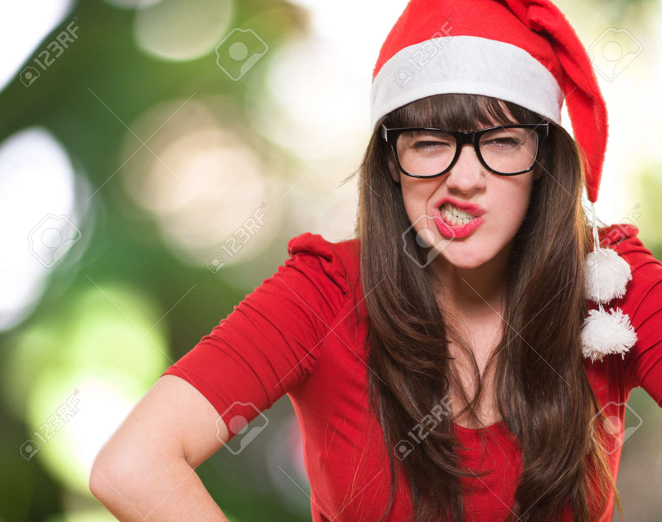 angry christmas woman wearing glasses against a nature background Stock Photo - 16290677