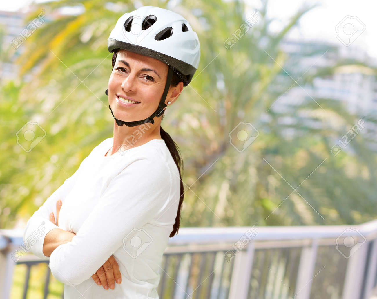 Woman Wearing Helmet With Hands Folded, Outdoor Stock Photo - 16289495