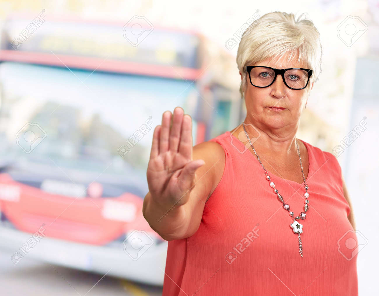 Portrait Of A Senior Woman Showing Stop Sign, Outdoor Stock Photo - 16289498