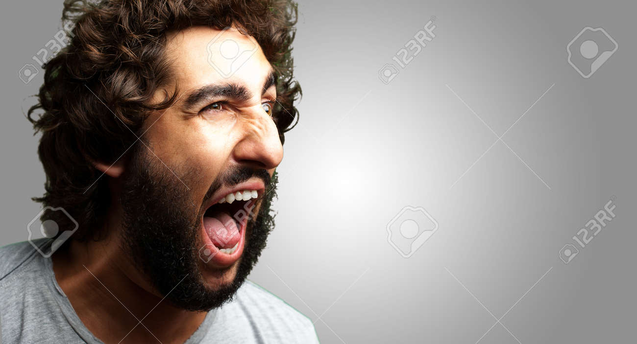 Portrait Of A Man Shouting On Grey Background - 16690623