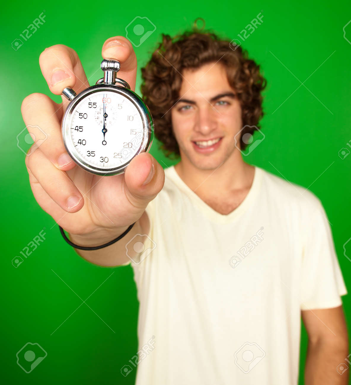 Man Holding Stopwatch On Green Background - 16671743