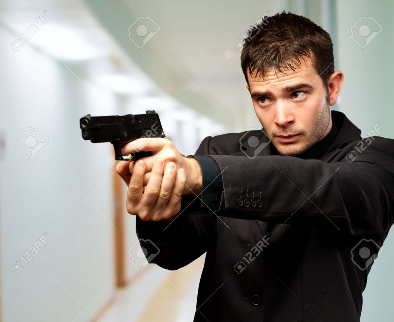 Man Holding Gun, indoor - 16672347