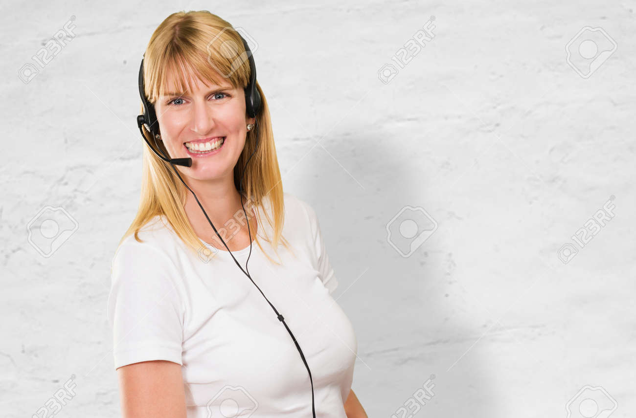 Happy Woman On Headset against a concrete background Stock Photo - 16672531