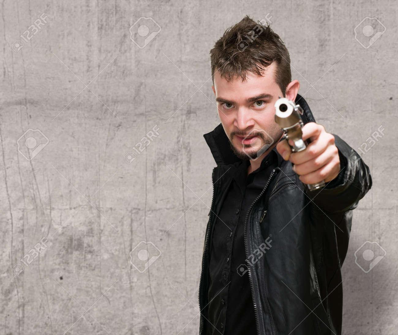 Man Holding Gun Down Portrait of a Man Holding Gun