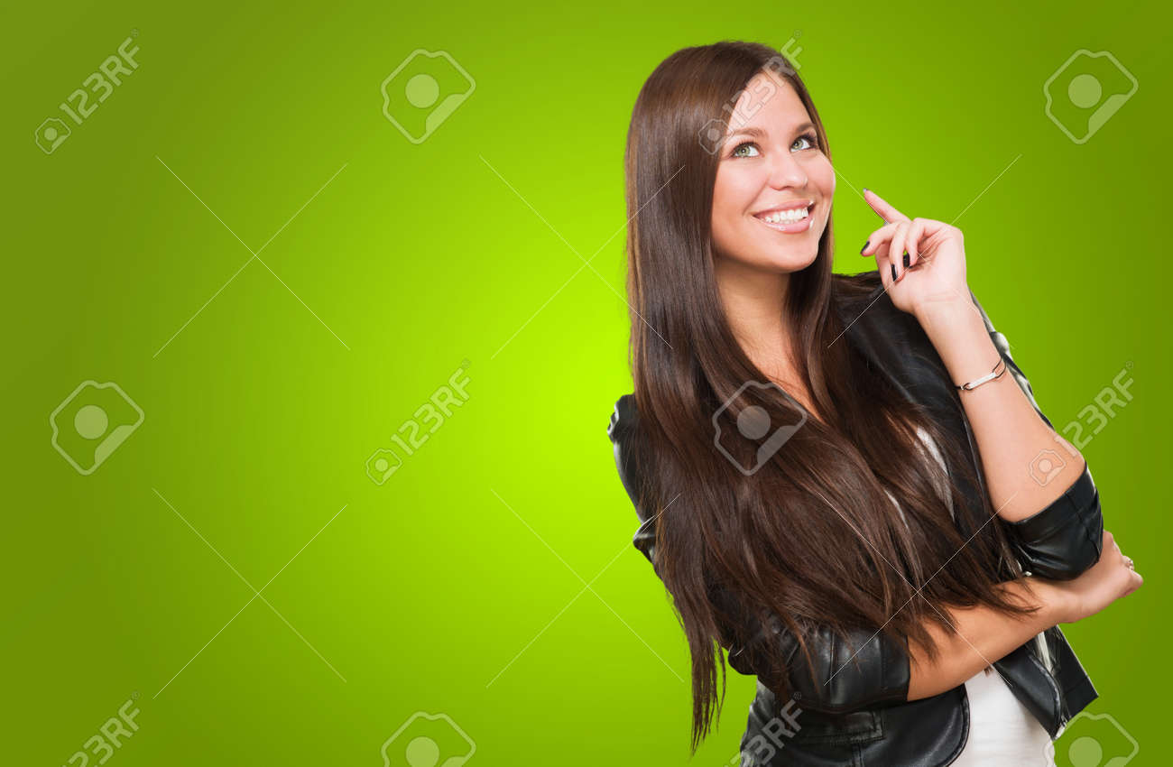 Portrait Of A Happy Woman against a green background - 16672455