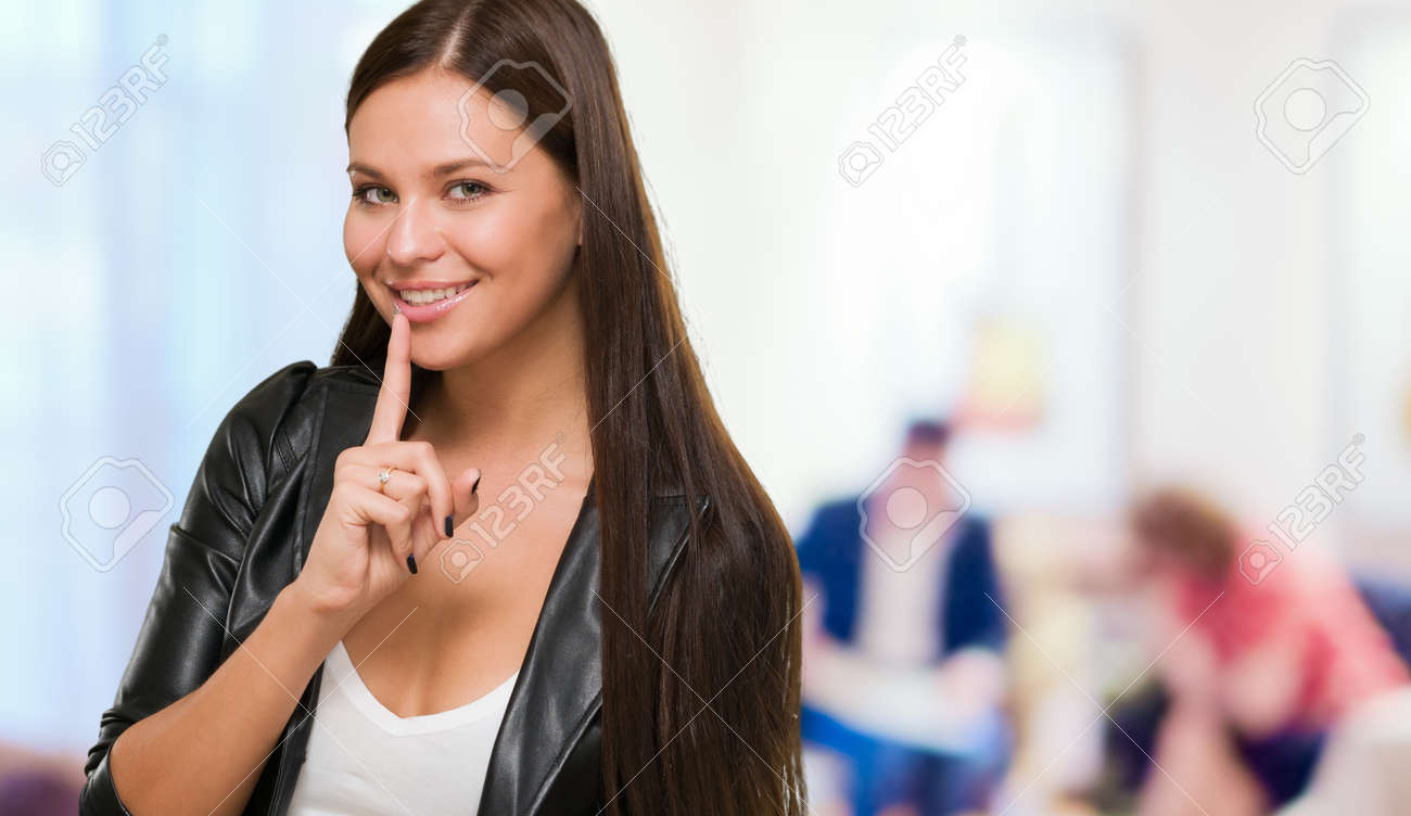 Pretty Woman Making A Keep It Quiet Gesture, indoor Stock Photo - 16672415