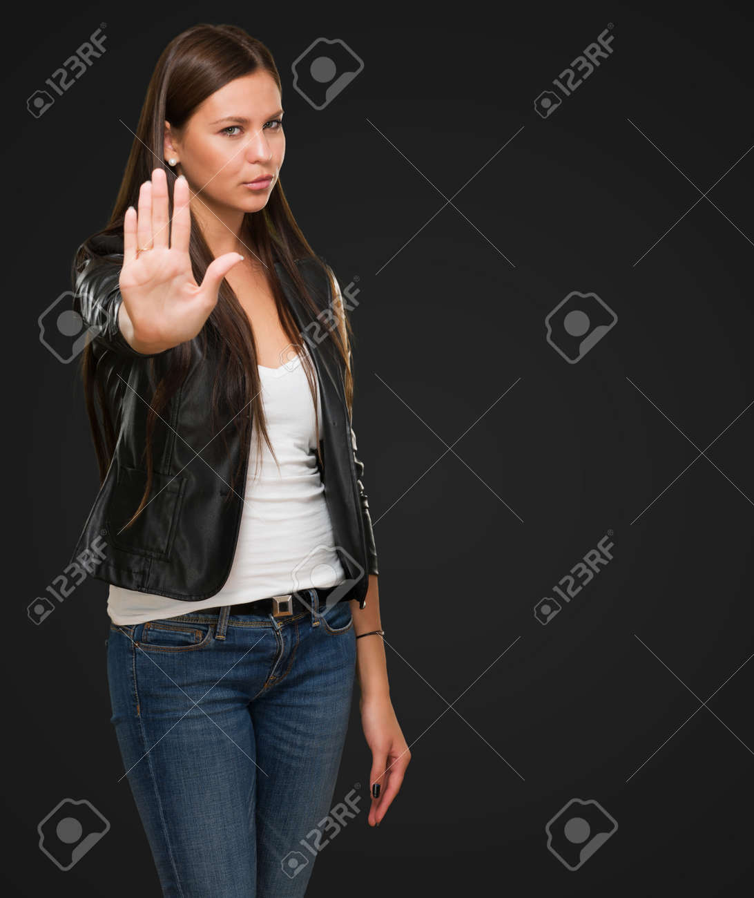 Young Woman Showing Stop Hand Gesture against a black background Stock Photo - 16672525