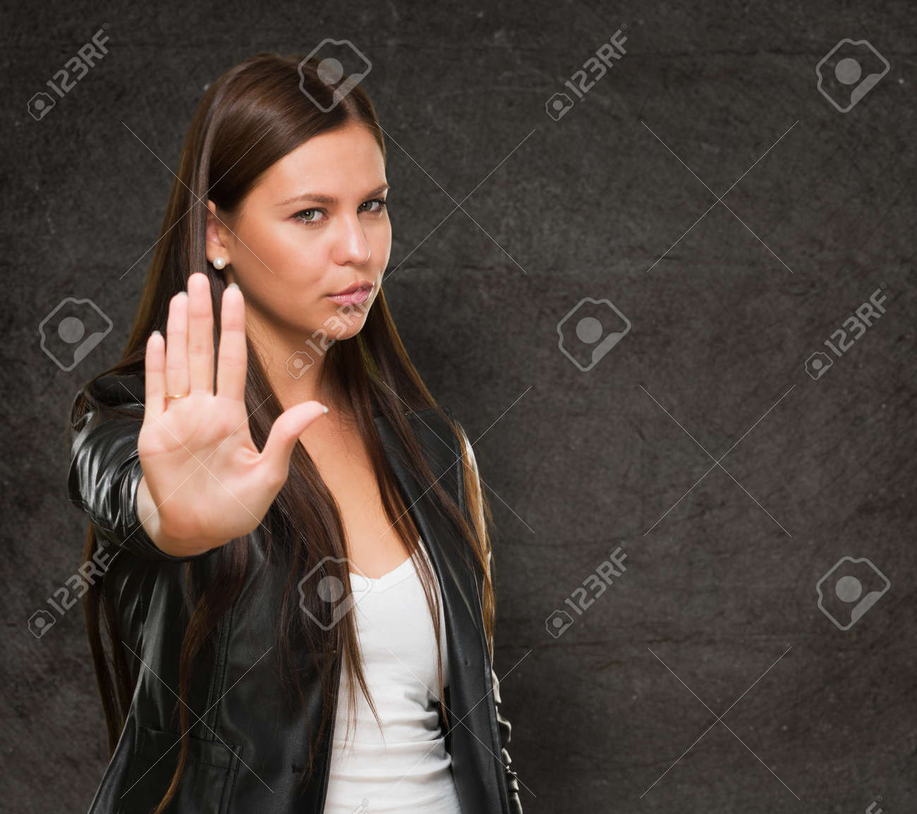 Young Woman Showing Stop Hand Gesture against a grunge background Stock Photo - 16672409