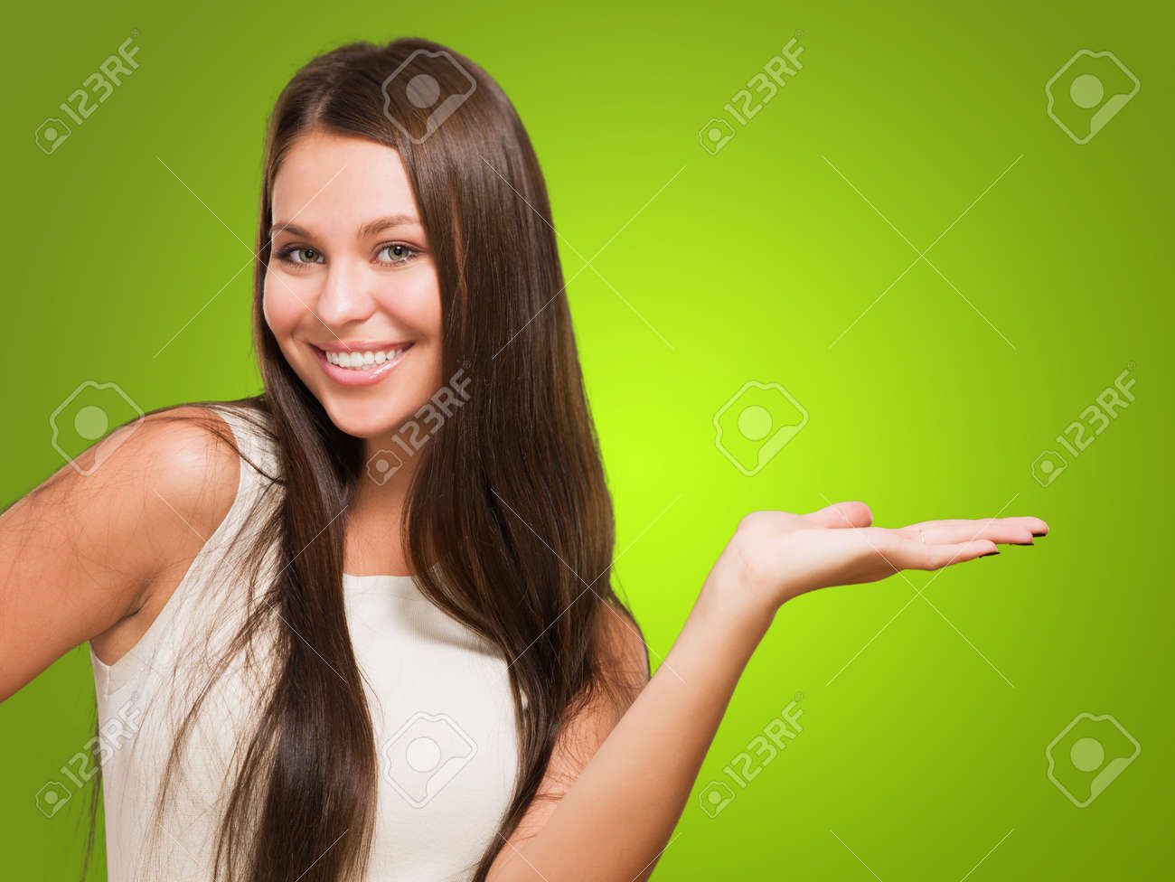 Happy Woman doing a gesture against a green background - 16671753