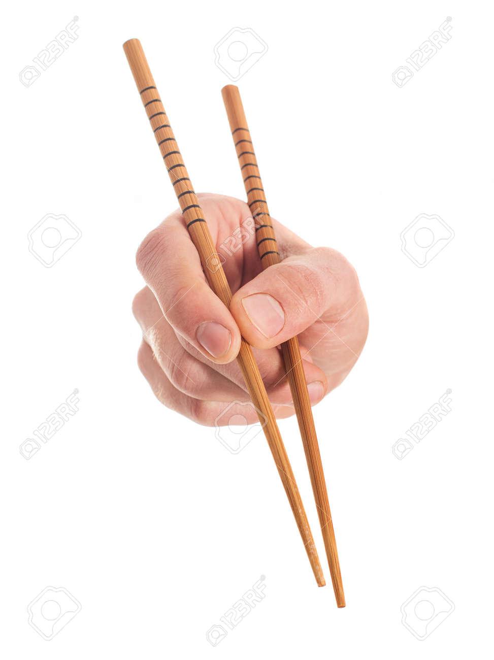 Close-up Of Hand Holding Chopsticks On White Background - 22036816