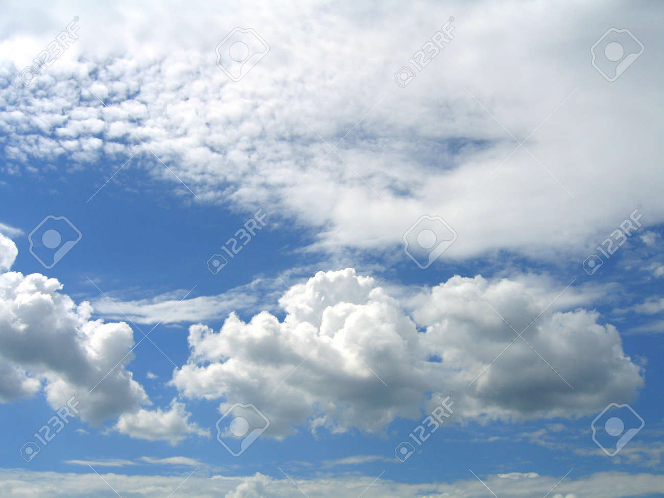 white fluffy clouds in the blue sky Stock Photo - 8289321