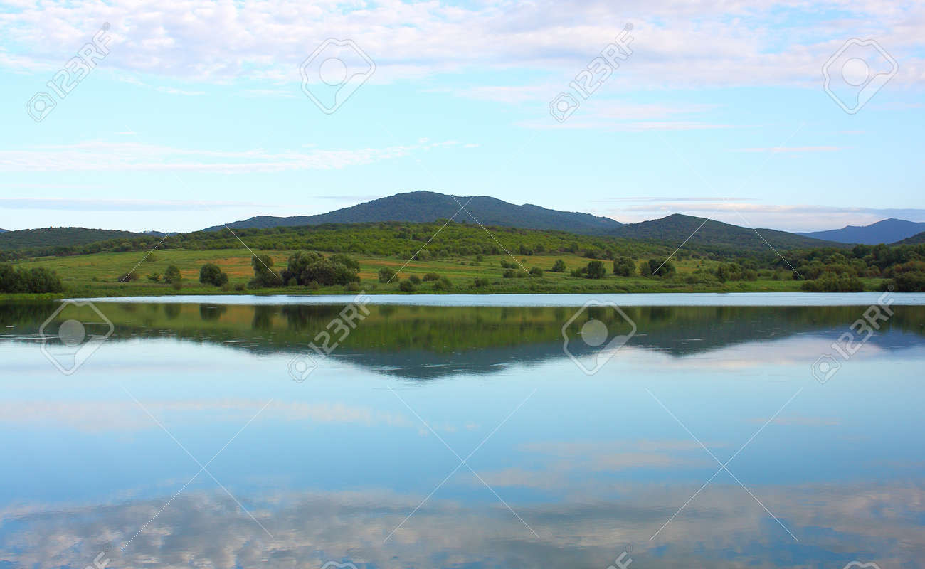 Landscape mountain lake against the sky in clouds Stock Photo - 8510807