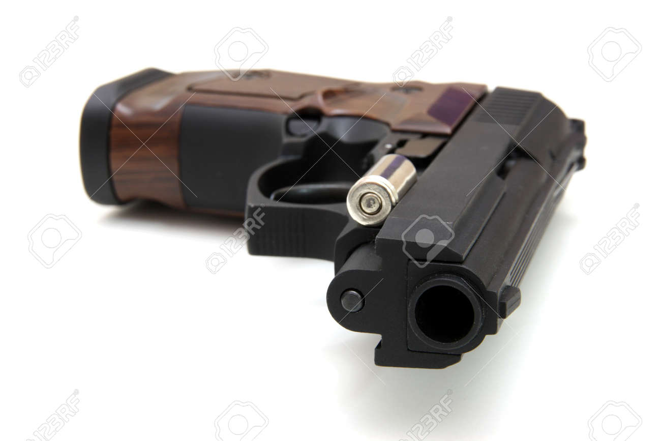 The close up of a pistol a target and cartridges is isolated on a white background Stock Photo - 8568624