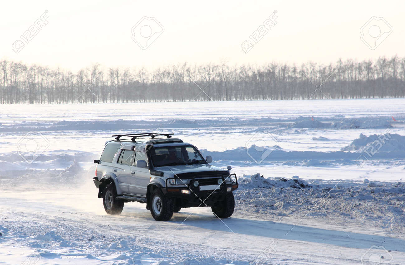 Car on winter road Stock Photo - 12551118