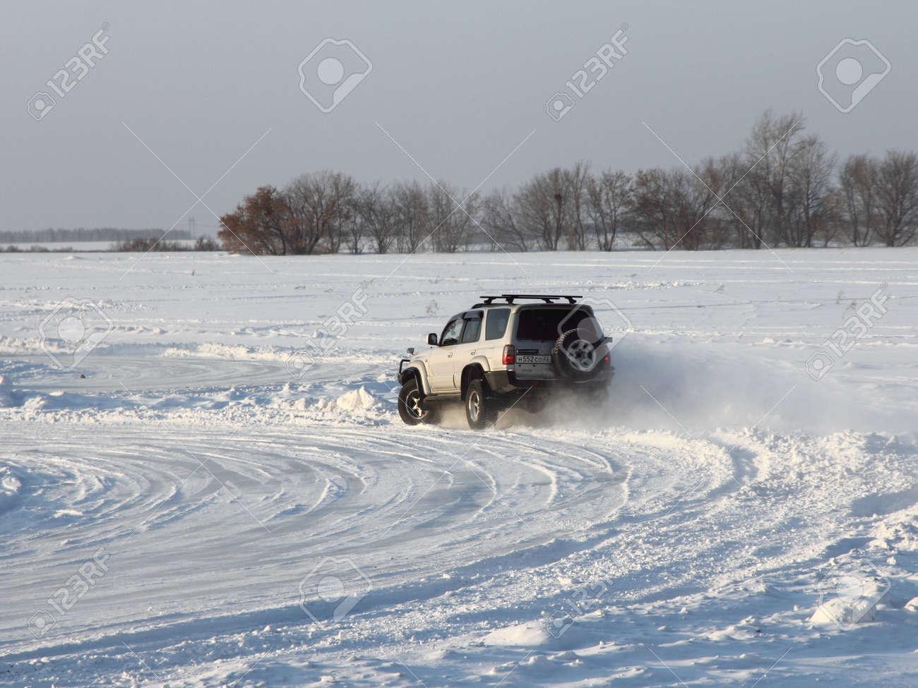 Car on winter road  Stock Photo - 12547311