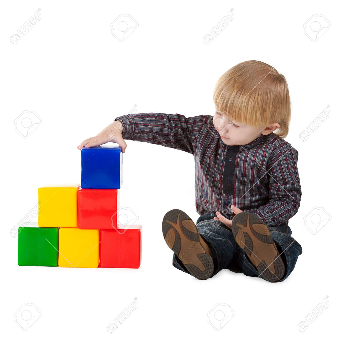 little boy plays with colorful cubes isolated Stock Photo - 12163240