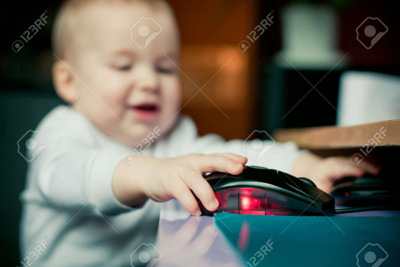 Little happy boy using computer mouse Stock Photo - 12163281