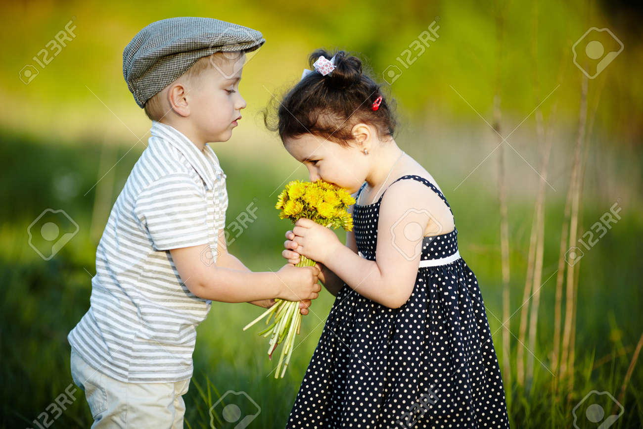 cute boy and girl on summer field stock photo, picture and royalty