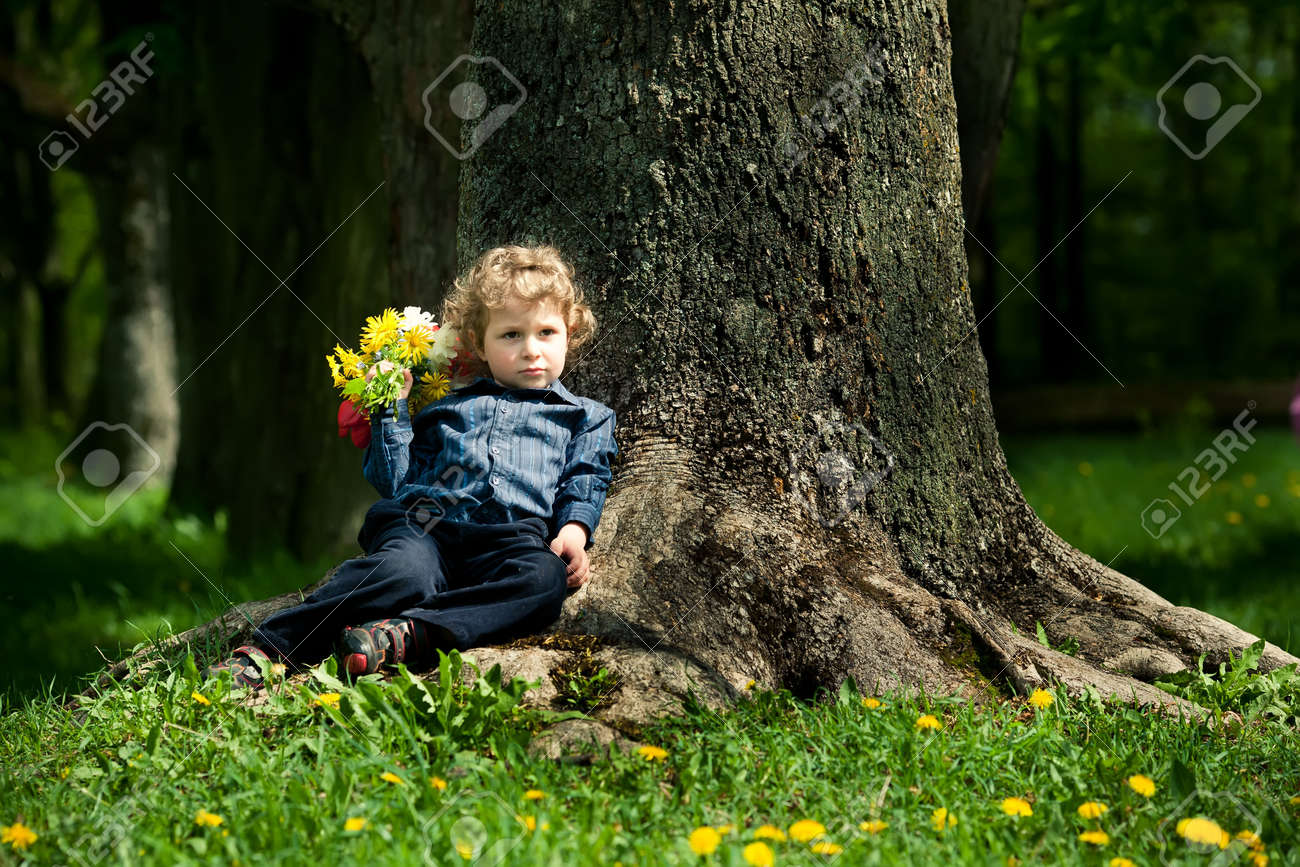 little boy with flowers Stock Photo - 18350730