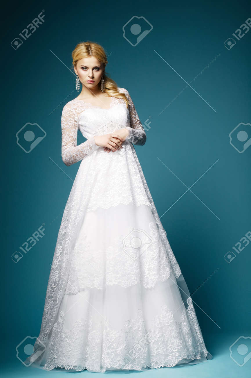 Beautiful Bride In Wedding Dress On Blue Background Stock Photo ...