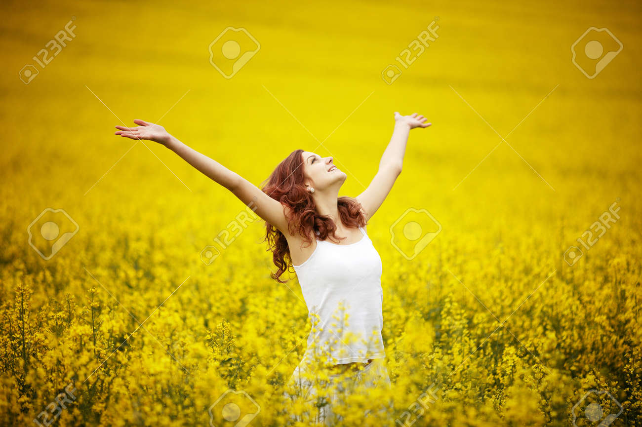 young beautiful girl in the field - 20921476