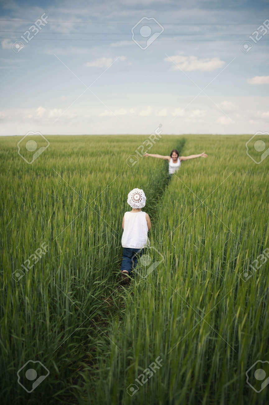 Mother meeting her baby in spring green field Stock Photo - 21647729