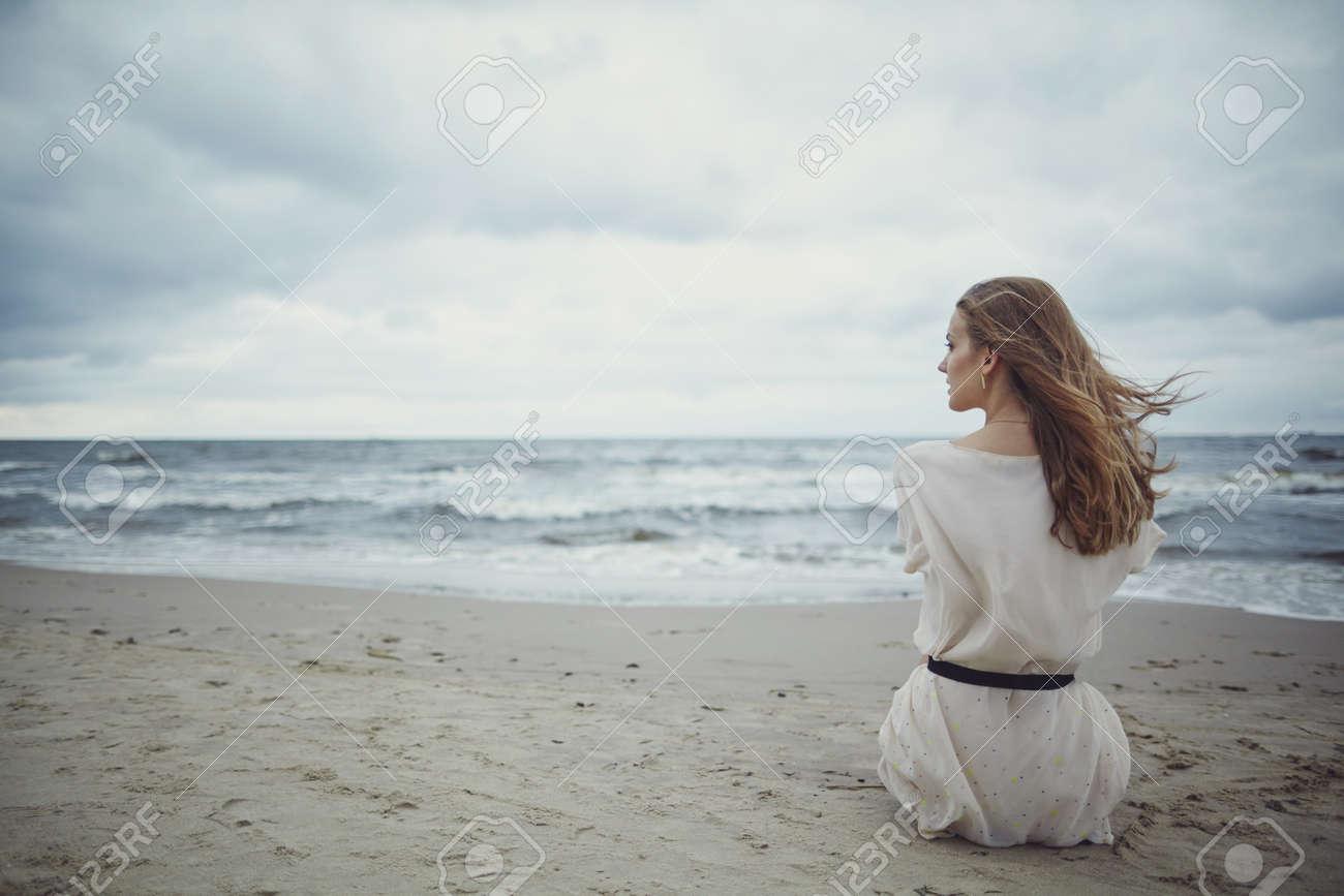 Beautiful alone sensual girl on the beach stock photo 45606018