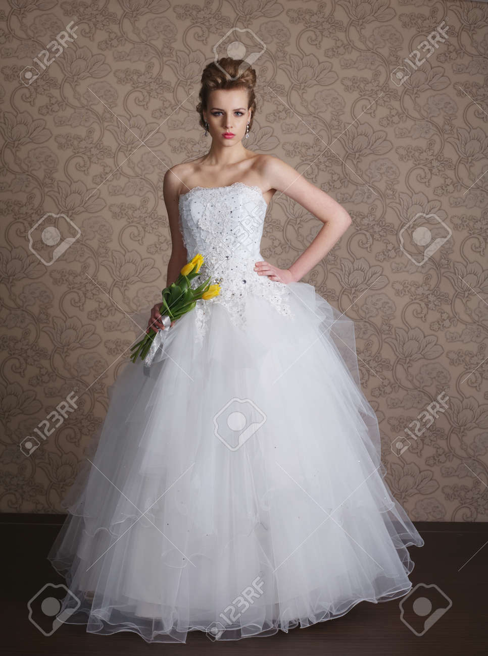 photo of young beautiful bride in wedding dress - 53728513