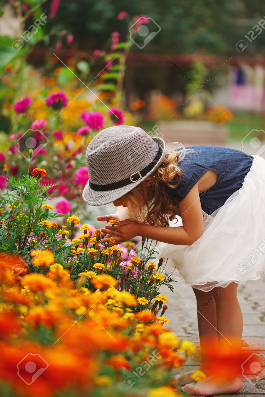 little beautiful girl in flowers park Stock Photo - 92882817