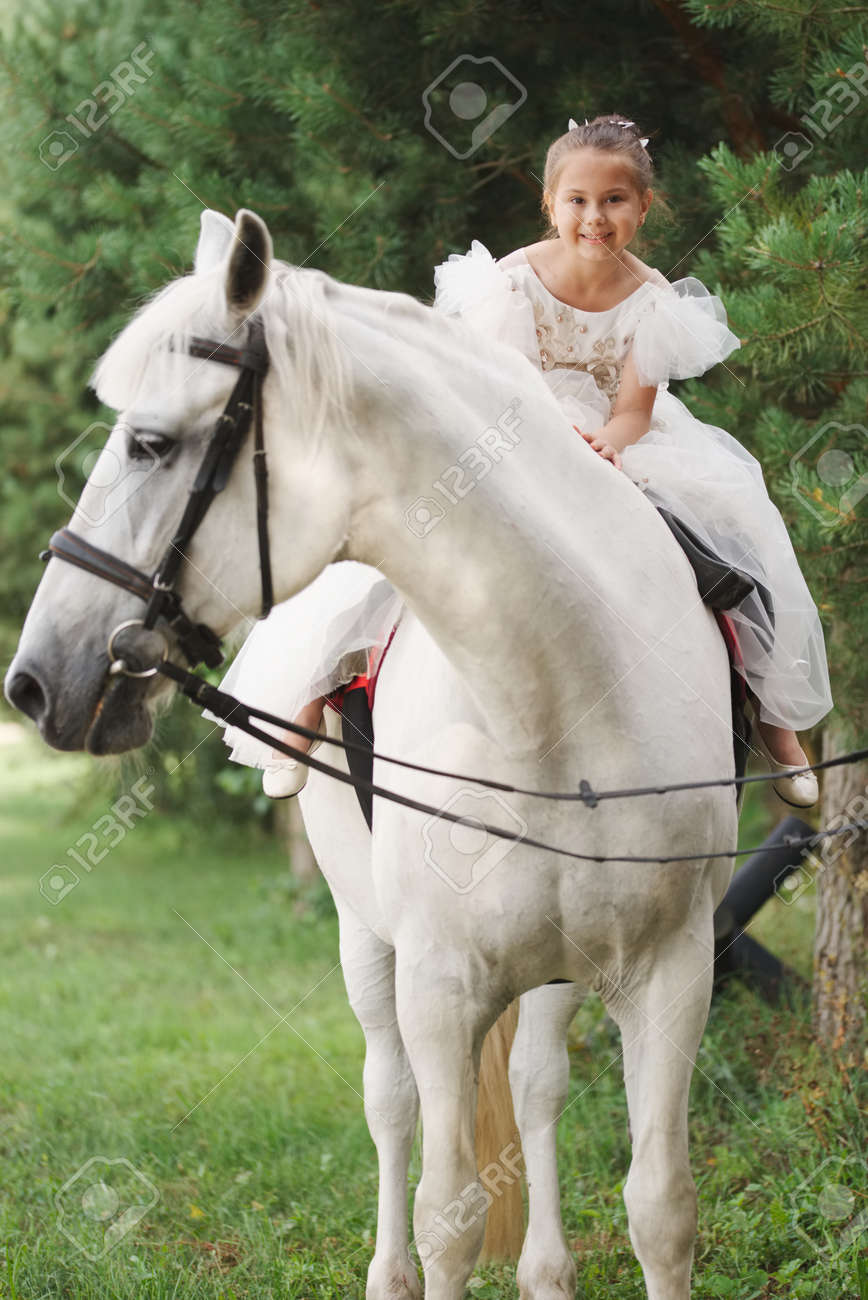 Happy Little Princess On White Horse In The Forest Stock Photo Picture And Royalty Free Image Image 122935200