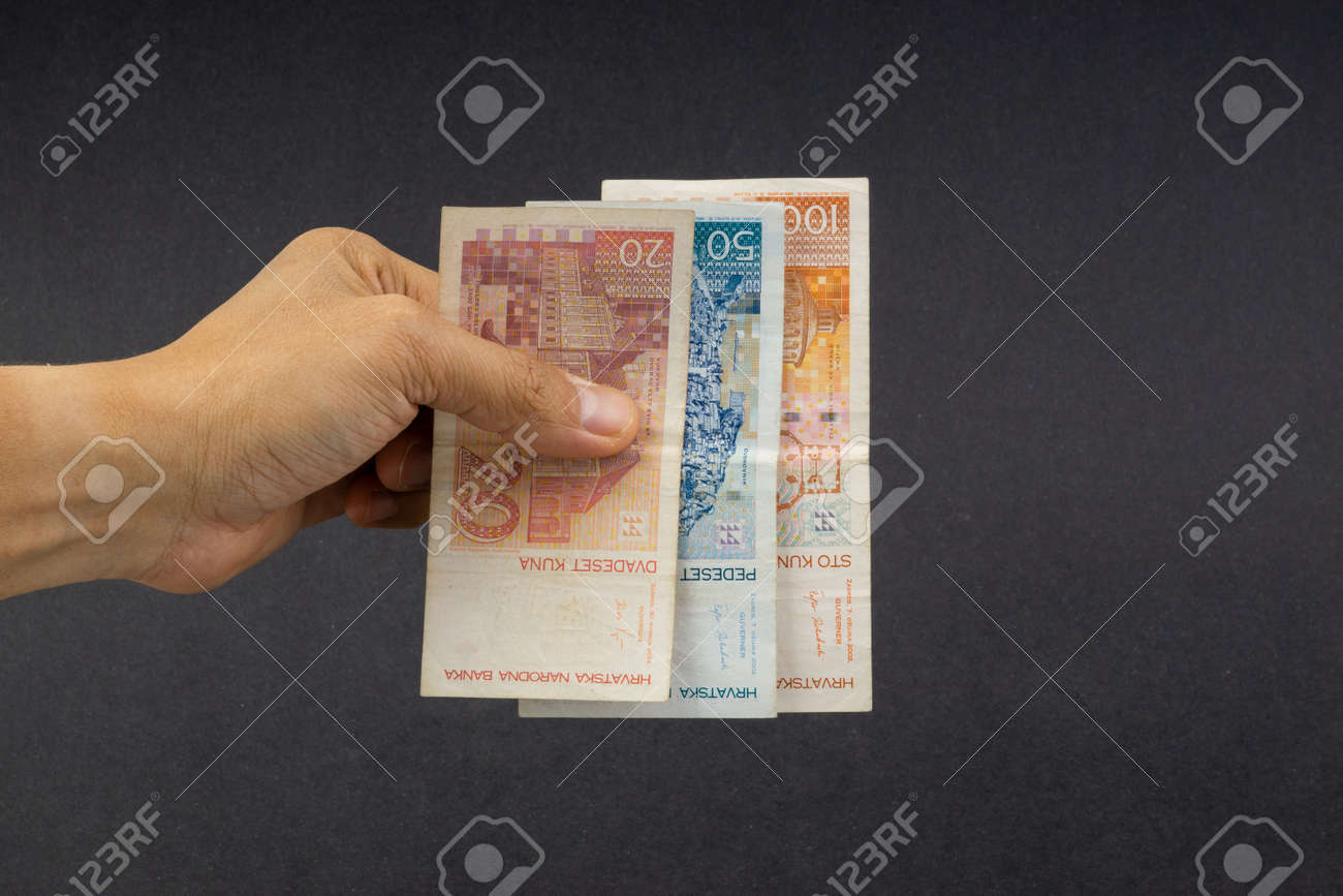 Hand Holding Fifty Croatian Kuna Or Sto Kuna Bank Notes On Black