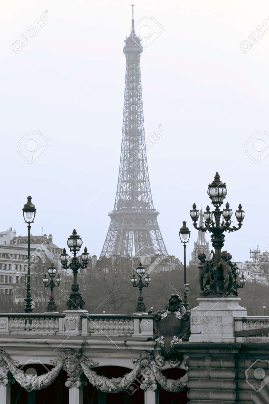 Lanterns on the bridge of Alexander III in the background of the Eiffel Tower in Paris. Stock Photo - 22422009