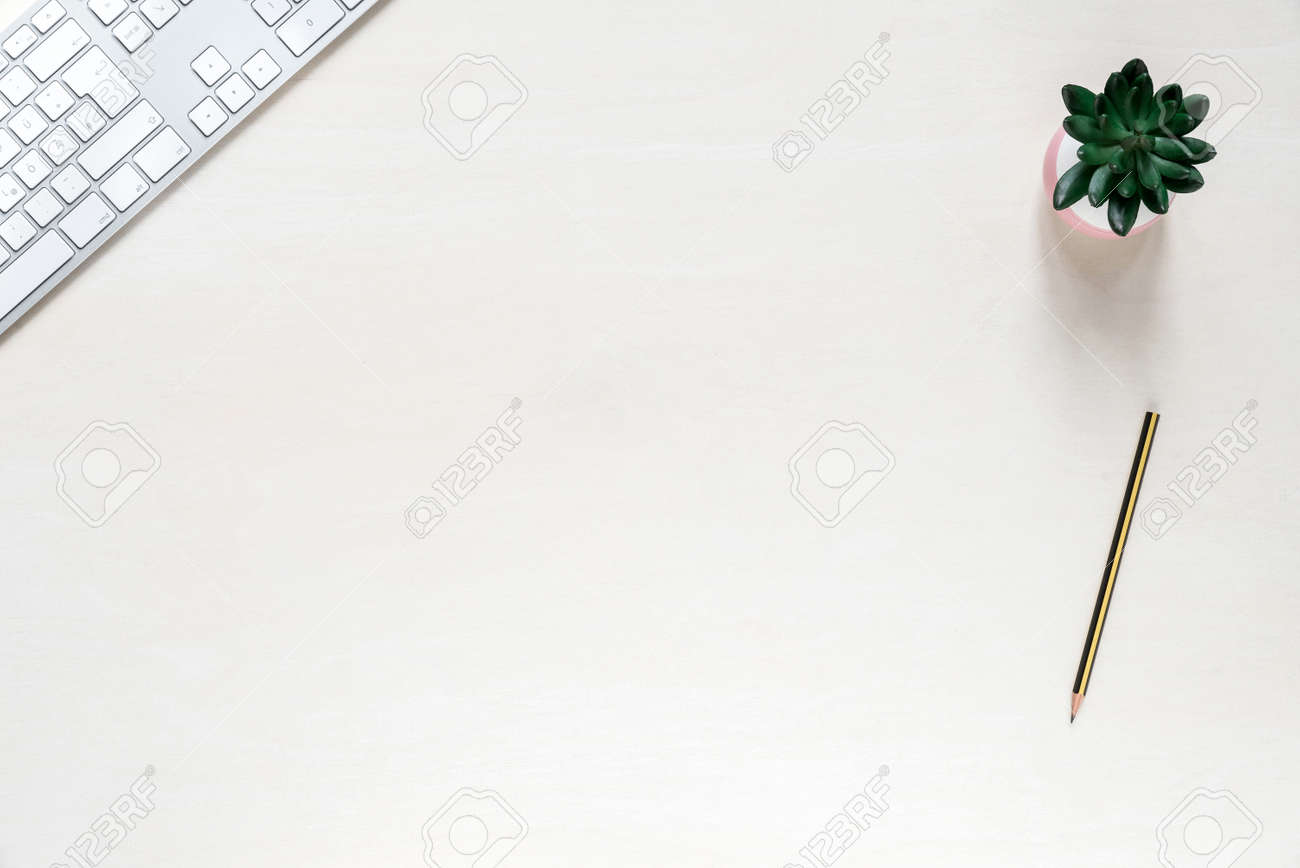 blank copy space on office desk background with keyboard pencil