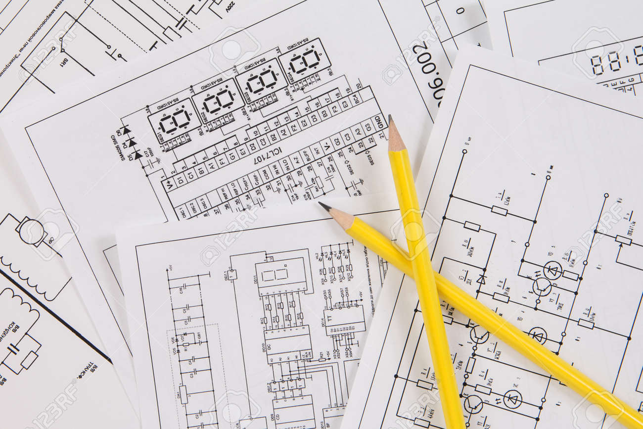 Two Pencil And Background Of Printed Electrical Drawings Stock Photo ...