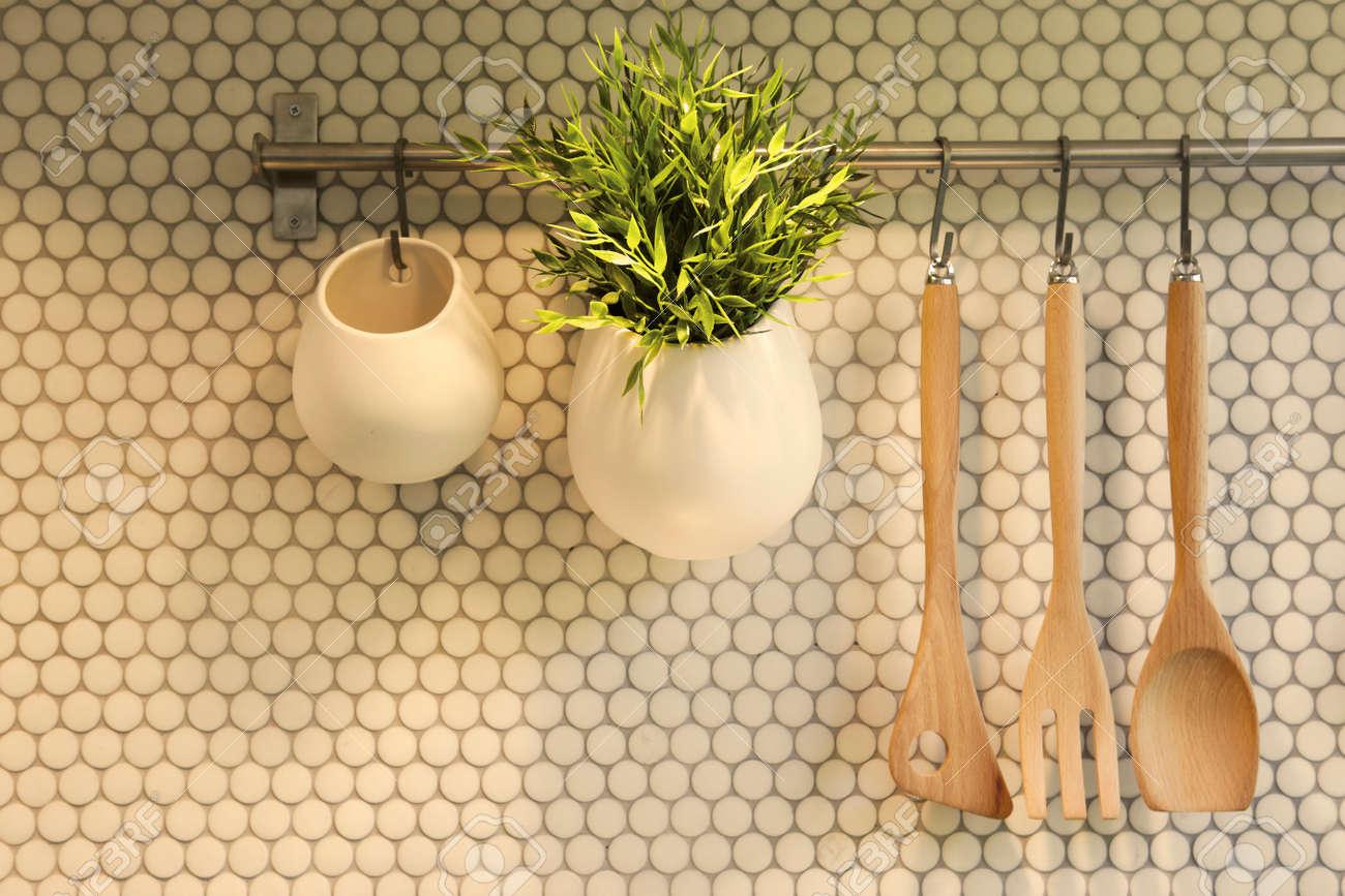 Set Of Kitchen Utensils Hanging On Wall Stock Photo   22276124