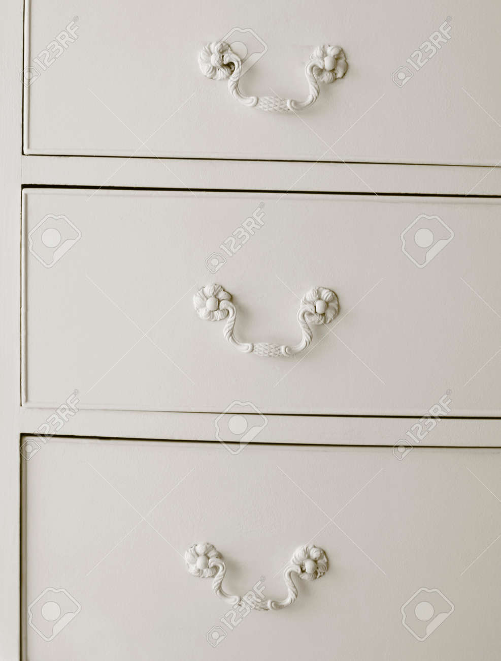 White Drawers With Old Fashioned Handles Vertical