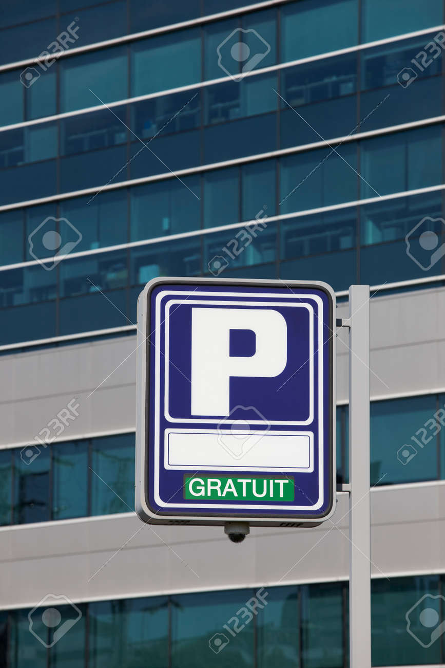 123Rf Gratuit parking signpost with gratuit text and modern building stock photo