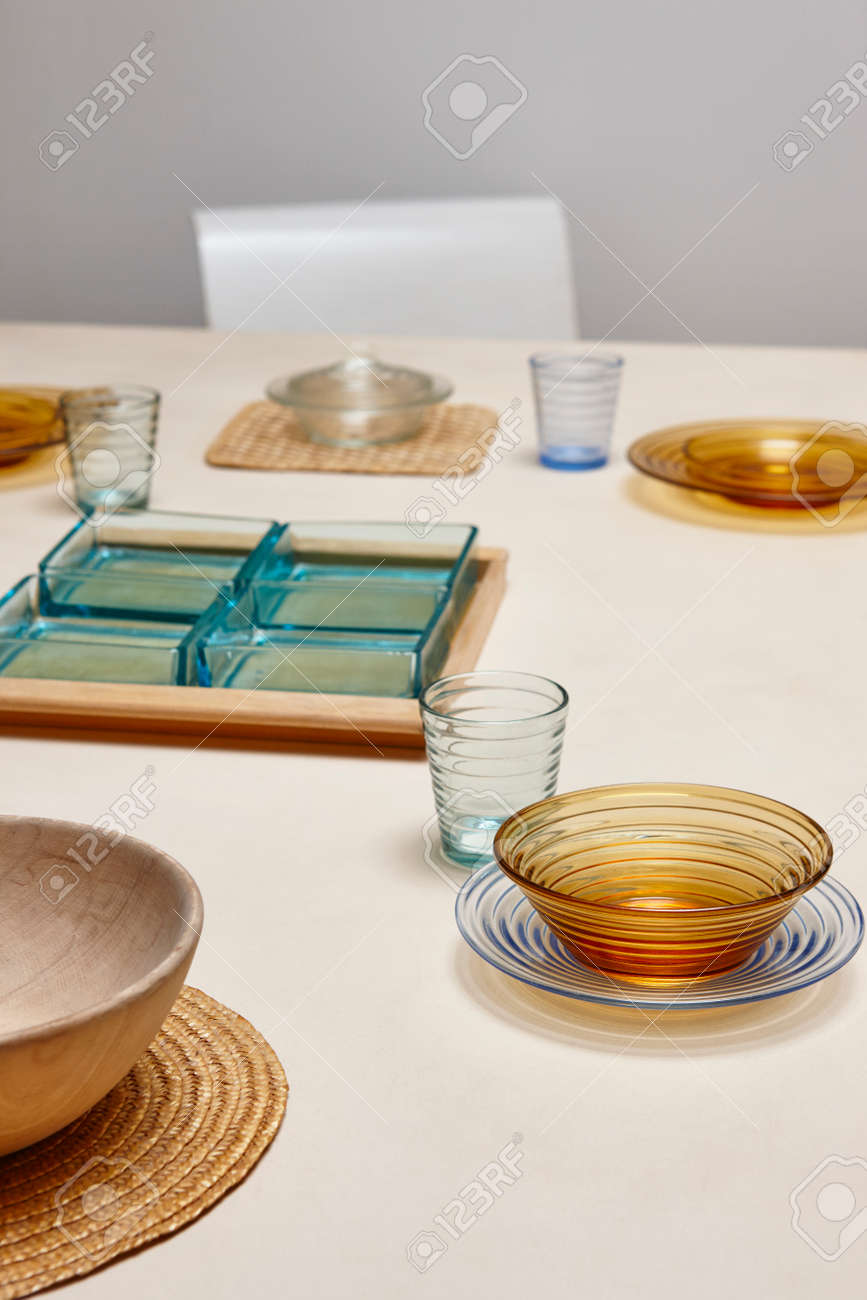 Elegant restaurant crystal tableware with colored dishes and glasses. Vertical Stock Photo - 88556664 & Elegant Restaurant Crystal Tableware With Colored Dishes And.. Stock ...