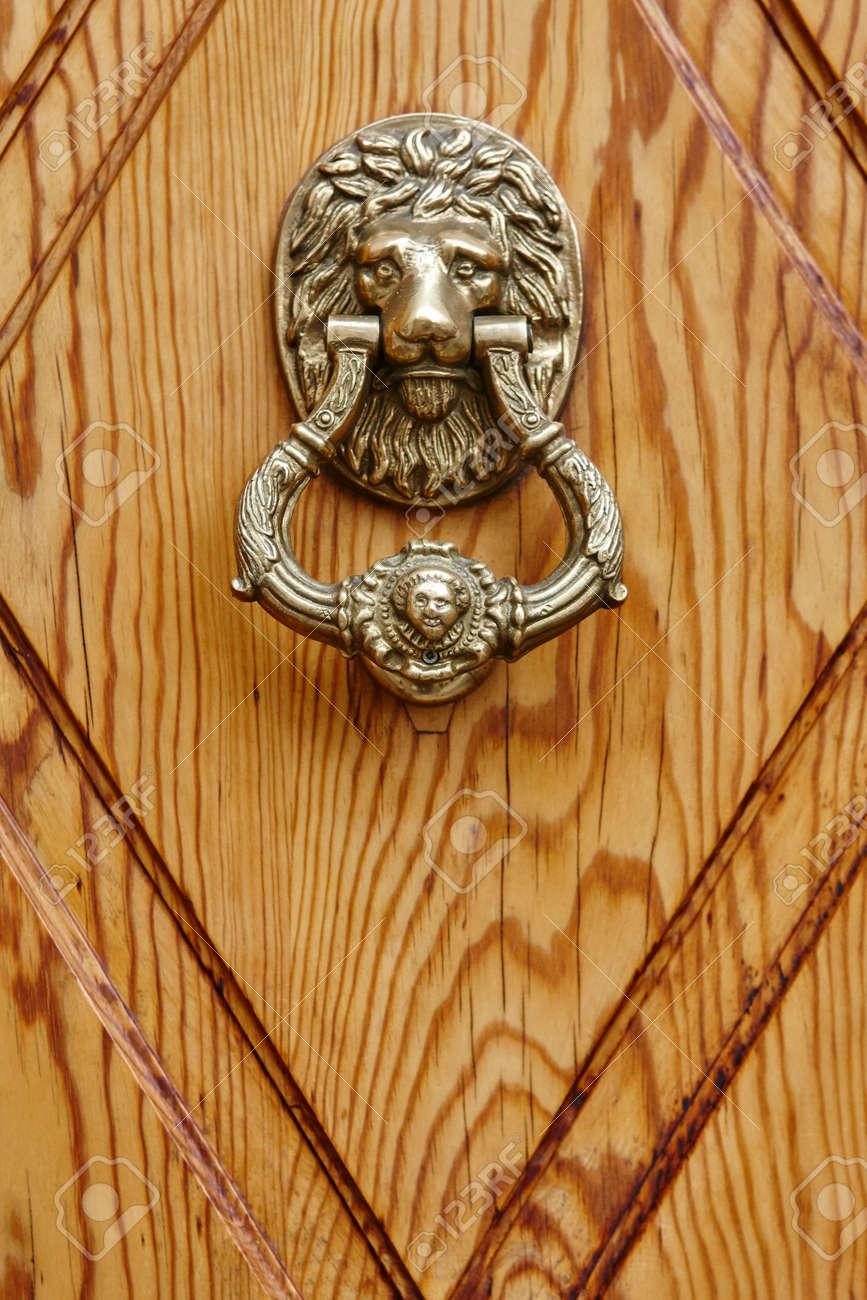 Golden Door Knob On A Wooden Door. Lion Head Handle Stock Photo ...