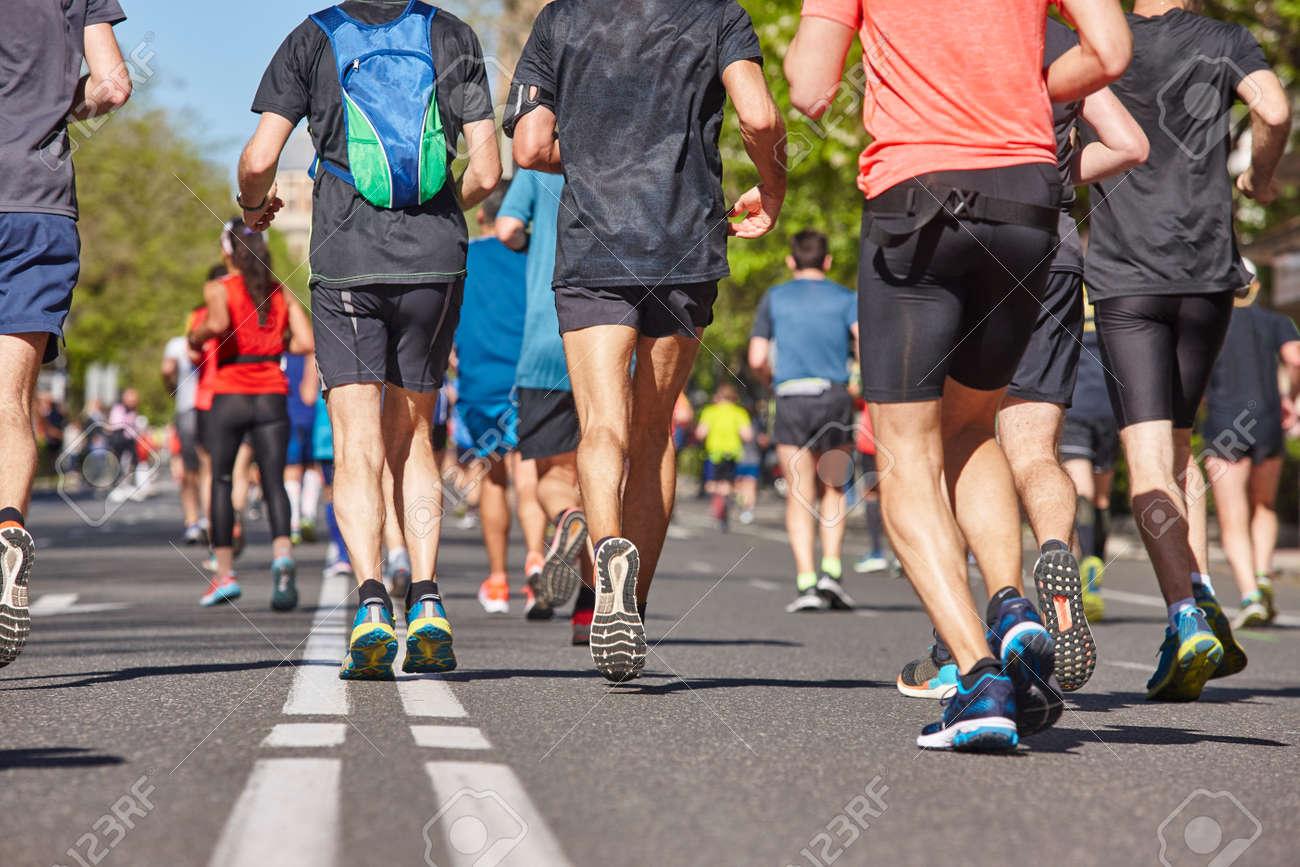 Marathon runners on the street. Healthy lifestyle. Urban athlete endurance - 131439790