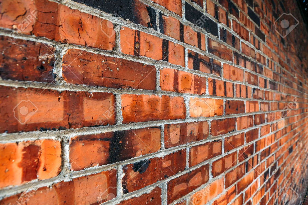 Perspective Side View Of Old Red Brick Wall Texture Background Stock Photo