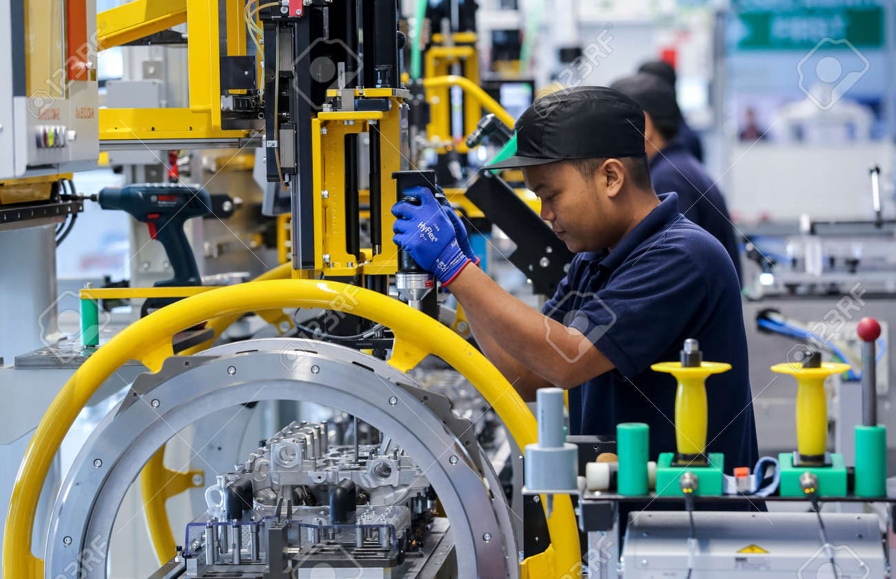 KEDAH, MALAYSIA - JULY 04, 2019 : Workers at engine assembly plant. Catering for both the domestic and export markets. Automotive & technology. - 130001621