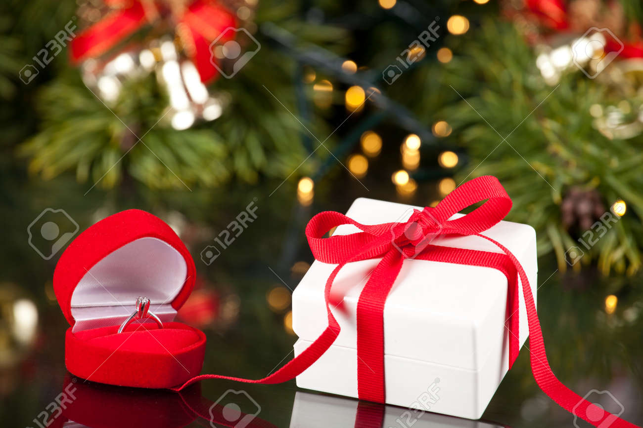 Engagement Ring In Christmas Ornament Part - 47: Engagement Diamond Ring In A Red Box And Present Stock Photo - 23864129