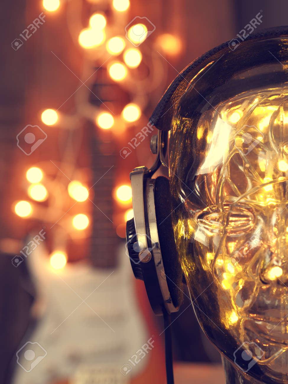 Rock Christmas Music.Headphones On A Glass Head With Christmas Lights Christmas Music